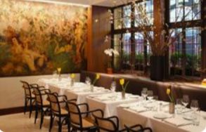 "<img src= ""restaurant.jpg"" alt= ""dining room in old building with long table iwith white table cloth and flowers"">"