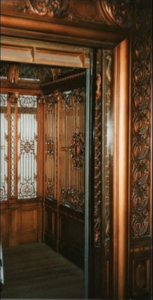 "<img src= ""elevator.jpg"" alt= ""ornate wooden elevator with rich carvings"">"