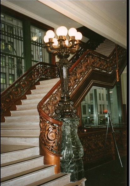 "<img src= ""staircase.jpg"" alt= ""ornate wooden staircase with large, tall lamp post with round bulbs"">"