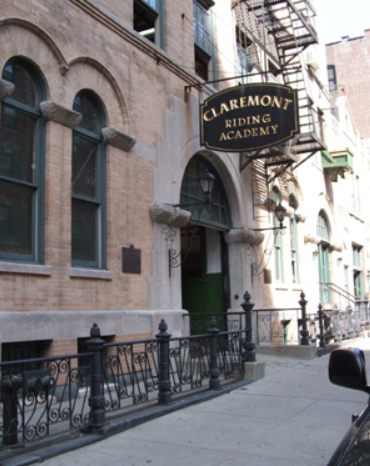 """<<img src= """"old building.jpg"""" alt= """"exterior of old building on empty street with sign that reads claremont riding academy """">"""